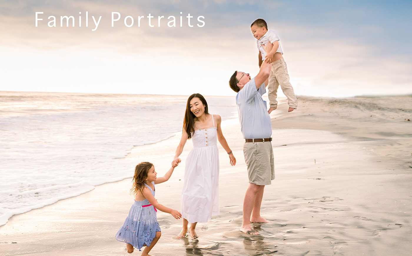 A family walking and posing for a photo at a family photo session the beach.